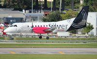 N327AG @ FLL - Silver Saab 340
