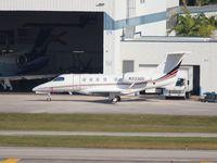 N333QS @ FLL - Net Jets Phenom 300
