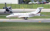 N335QS @ FLL - Net Jets Phenom 300
