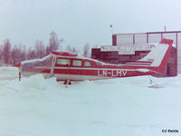 LN-LMV @ ENDU - Scanned from negative. Pictured at a snowy Bardufoss airport, Norway. This aircraft was destroyed in a crash 2004-09-14 - by Clive Pattle