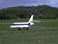 CS-DLH @ EGPH - Netjets Falcon 2000EX CS-DLH taxiing to runway 06 - by Mike stanners
