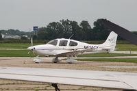 N614CY @ KAMW - Photographed by hanging over a fence and shooting over the wing of a twin Cessna. - by Glenn E. Chatfield
