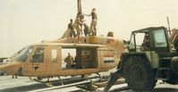 5722 @ QJB - HMLA 369 Flight Line Crew dismantling 214ST for transport during desert storm.. (Me) CpL Sal Briones wearing sun glasses.. Had Sgt  Joe Unwin take photo using my disposable camera - by HMLA 369 Mechanic-Possibly Sgt  Joe Unwin