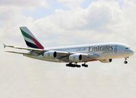 A6-EOI @ EHAM - Landing on runway 27 of Schiphol Airport - by Willem Göebel