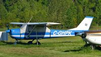 C-GHPK @ CYCD - Parked in the grass field at Nanaimo airport. - by M.L. Jacobs