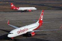 D-ABMO @ EDDT - Two ways to present one airline.... - by Holger Zengler