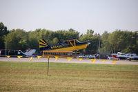 N464SC - Landing at Oshkosh 2015 - by jbarber
