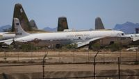 N830CS @ DMA - C-118B in a private boneyard