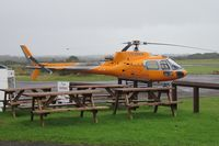 G-ERKN @ EGFH - Visiting Ecureuil helicopter operated by Jet Helicopters Ltd. Note new orange paint job. - by Roger Winser
