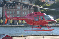 SE-HKP - Departing helipad near Old Town in Stockholm, Sweden.