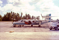 DQ-FCE @ TRW - Actually taken by my father sometime around 1975, DQ-FCE at Bonriki, Tarawa with our Mini Moke. https://www.flickr.com/photos/marktranchant/19709589330 - by Mark Tranchant