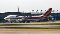 N704CK @ KATL - Boarding ladder at Atlanta - by Ronald Barker