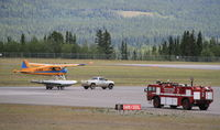 C-GZXV @ CYXY - On floats, being launched from a trailer on a paved runway at Whitehorse, Yukon. - by Murray Lundberg