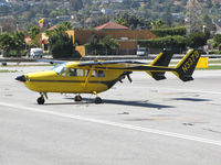 N337B @ KSQL - Colorful 1967 Cessna T337C @ @ San Carlos Airport, CA - by Steve Nation