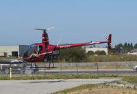 N111AH @ KSQL - San Carlos Flight Center 2004 Robinson R22 BETA hovering at end of training flight @ San Carlos Airport, CA - by Steve Nation