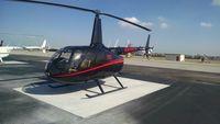 N826CE @ KTOA - New Robinson R66 with Garmin 500H, autopilot, radar altimeter, sitting on the ground.