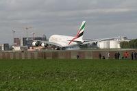 A6-EEV @ EBBR - Flight EK183  -  touch down on RWY 25L - by Daniel Vanderauwera