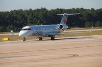 C-FSKM @ KIAH - Canadair taxing to its gate at KIAH. - by Eric Olsen