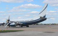 N8767 @ MCO - Boeing BBJ