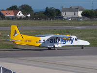 CS-TGG @ EGJB - Taxying to stand at Guernsey (taken through the terminal windows) - by alanh