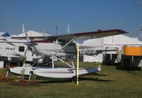 C-GFYF @ KOSH - Cessna A185F - by Mark Pasqualino