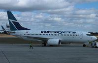 C-FGWJ @ CYXU - Boeing737-700 - by Mark Pasqualino