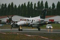 74 @ LFRN - Embraer EMB-121AN Xingu, Taxiing to holding point, Rennes-St Jacques airport (LFRN-RNS) Air show 2014 - by Yves-Q