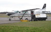 G-SYLV @ EGFH - Engine start using a GPU for resident Grand Caravan operated by Skydive Swansea. - by Roger Winser