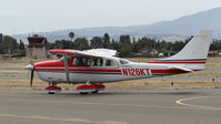 N126KT @ KRHV - California-based 1979 Cessna TU206G clear of runway 31R taxing to Nice Air for a visit at Reid Hillview Airport, San Jose, CA. - by Chris Leipelt