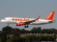 G-EZWY @ LFBO - Landing rwy 14R - by Shunn311