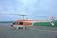 OO-COP @ EDDK - Agusta-Bell AB.206B Jet Ranger II [8284] (Publi Air) Cologne-Koln Bonn~D 20/05/1982. From a slide.