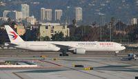 B-2022 @ KLAX - Boeing 777-39P(ER) - by Mark Pasqualino