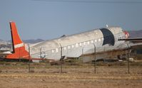N9059J @ DMA - C-118A in a private scrapyard near Davis Monthan