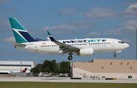 C-FLWJ @ FLL - West Jet - by Florida Metal