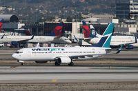 C-FWSE @ KLAX - Boeing 737-800 - by Mark Pasqualino