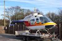 DU-103 @ EGNP - airframe parked on trailer at Coneypark heliport next to LBA in UK(EGNM) with rotors and parts missing, no identification and not totally confirmed to be c/n 1193, - by Jez-UK