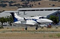 N122CR @ E16 - Locally-based 2013 Embraer Phenom 100 landing at South County Airport, San Martin, CA. Owned by Christopher Ranch LLC, a garlic farm out of nearby Gilroy. - by Chris Leipelt
