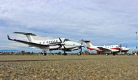 UNKNOWN @ KRHV - Two King Airs parked next to each other, both for a 49er football game at Reid Hillview Airport, San Jose, CA. One is a King Air 250 from Central California and one is a King Air 200 from Southern California. No tail numbers on aircraft as per request. - by Chris Leipelt