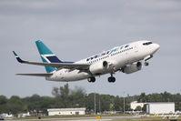 C-GWSQ @ KSRQ - WestJet Flight 1187 (C-GWSQ) departs Sarasota-Bradenton International Airport enoute to Toronto-Pearson International Airport - by Donten Photography