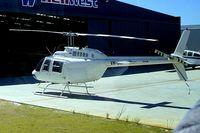 VH-BIN @ YPJT - Bell 206B-2 Jet Ranger II [2019] (Heliwest) Perth-Jandakot~VH 30/03/2007. Taken through the glass of the coach.