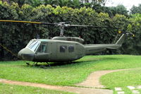 66-17063 - Bell UH-1D converted to UH-1H ex US Army ex SVNAF 233 sq. Static display at Chok Chai Aviation Museum in Pak Chong Thailand (Hiway #2). Aircraft wrongly marked as 9911 USMC. - by Jean M Braun