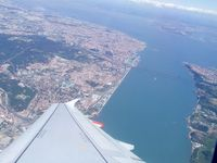 CS-TTG @ LPPT - overwing shot from leaving LPPT with most of Lisbon and surrounding areas visible, on route to EGCC - by Jez-UK