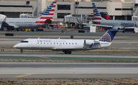 N984CA @ LAX - United Express - by Florida Metal
