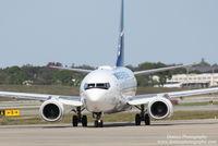 C-FWSF @ KSRQ - WestJet Flight 1187 (C-FWSF)  prepares for flight at Sarasota-Bradenton International Airport - by Donten Photography