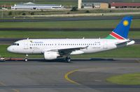 V5-ANK @ FAJS - Air Namibia A319 towed to its gate after some tlc at SAA mainanance facility. - by FerryPNL