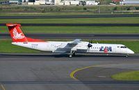 C9-AUM @ FAJS - LAM Dash8 taxying past - by FerryPNL