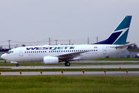 C-FWBW @ CYUL - Boeing 737-7CT [33697] (West Jet) Montreal-Dorval~C 16/06/2005 - by Ray Barber
