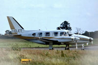 I-ELET @ EGGW - Piper PA-31-310 Turbo Navajo B [31-7400986] Luton~G 06/07/1974. From a slide. Taken through wire fence.