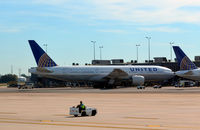 N209UA @ KIAD - At the gate Dulles - by Ronald Barker