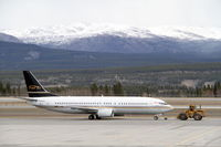 C-FLEJ @ CYXY - Under tow in Whitehorse, Yukon, while covering an Air North crew-move contract. - by Murray Lundberg